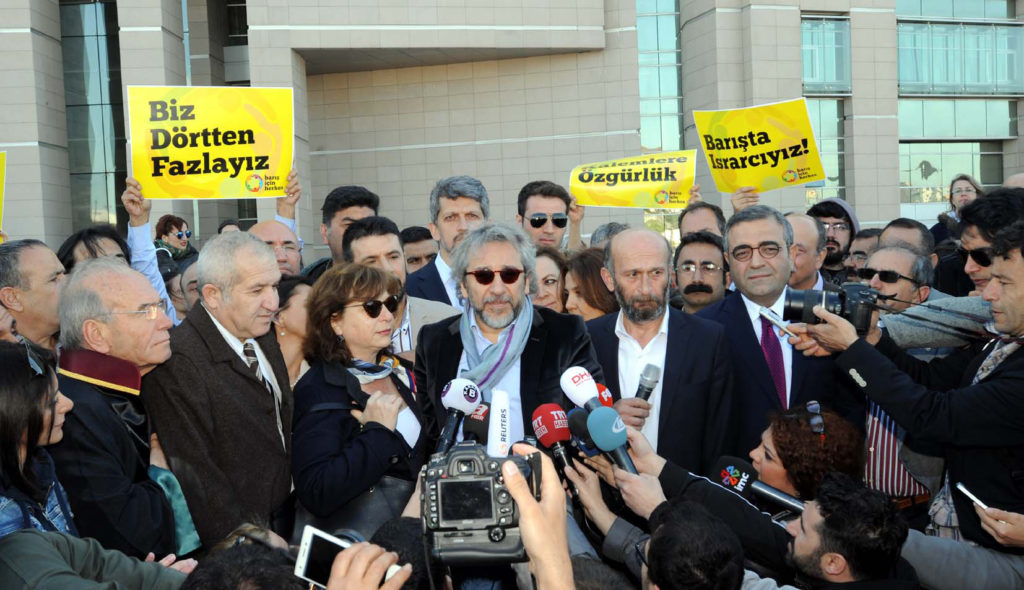 Turkish journalists Dundar and Gul speak to press after trial