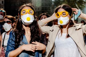 Untitled (Female protesters watch police fire tear gas canisters nearby, Istanbul, June 2013)