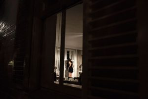 Untitled (A woman looks out the window for her lover)