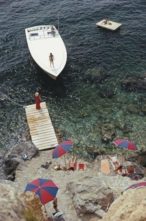Coming Ashore: A Magnum motorboat belonging to Count Filippo Theodoli arrives at the private jetty of the Il Pellicano Hotel in Porto Ercole, Italy, August 1973