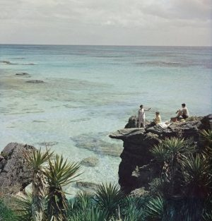 A Nice Spot for Lunch: A group enjoy a picnic at a rocky coastline in Bermuda, 1957